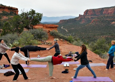 Sedona-Grand Canyon Retreat guests doing yoga on guided Sedona Spirit Yoga vortex hike